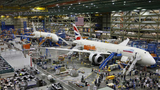 Workers assemble Boeing 787 Dreamliners, the wide-body twin-engine jets made by Boeing Commercial Airplanes at the Boeing Everett Factory in Everett, Washington.
