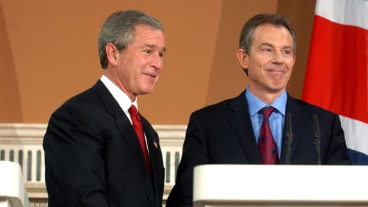 George Bush and Prime Minister Tony Blair shaking hands at a press conference at the Foreign Office in London.