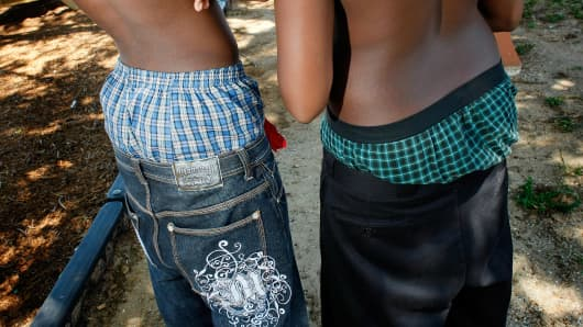 A file photo of two young men wearing their pants with underwear showing.