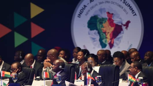 Leaders including Guinea-Bissau's President José Mário Vaz (2L) Guinea's President Alpha Condé (C) look on during the India-Africa Forum Summit in New Delhi on October 29, 2015.