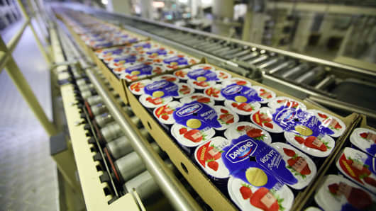 Cartons of strawberry yogurt pass along a conveyor belt before packaging at the Group Danone in Russia dairy production plant