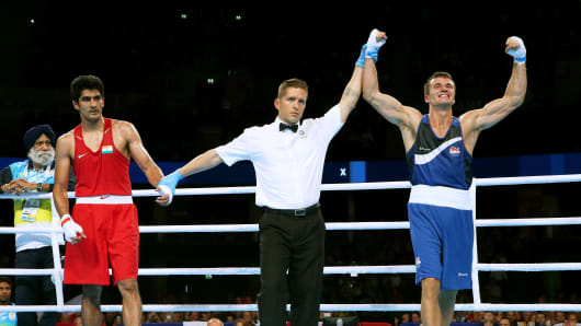 Antony Fowler of England celebrates winning the gold medal against Vijender Vijender of India in the Men's Middle (75kg) Final at SSE Hydro during day ten of the Glasgow 2014 Commonwealth Games on August 2, 2014 in Glasgow, Scotland.