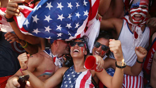 U.S. supporters celebrate after their loss to Germany after watching the match at FIFA Fan Fest on June 26, 2014 in Rio de Janeiro, Brazil.