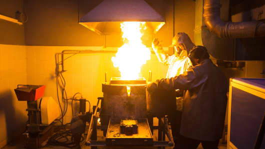 Workers use a furnace to melt gold during the casting of gold ingots at the Suzdal gold mine, operated by Nordgold NV, in Semey, Kazakhstan, on Tuesday, June 7, 2016.