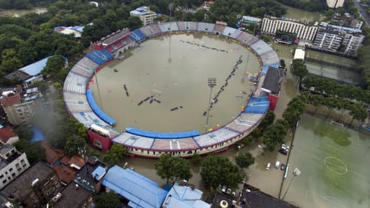 This picture taken on July 6, 2016 shows the flooded Xinhua Road Sports Centre Stadium in Wuhan, central China's Hubei province.