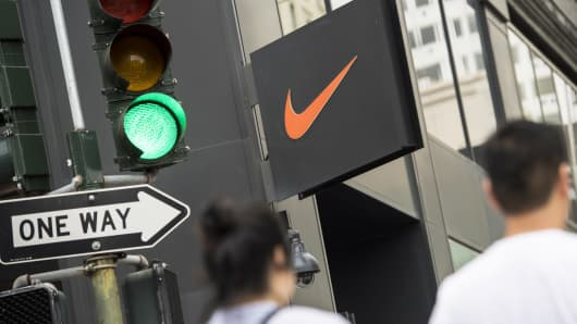 Pedestrians walk past a Nike store in San Francisco.