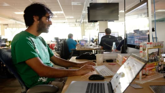 A 23-year-old works at his desk at Rally Software Development in Boulder, Colorado.