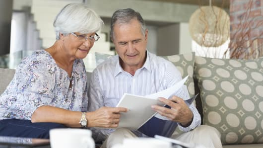 Couple reading documents, retirees