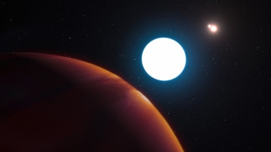 An artist's impression shows a view of the triple star system HD 131399 from close to the giant planet orbiting in the system. The planet is known as HD 131399Ab and appears at the lower-left of the picture. HD 131399Ab is about 16 million years old, making it also one of the youngest exoplanets discovered to date.
