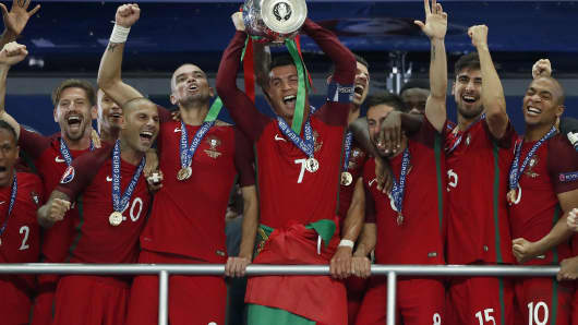 Bruno Alves, Ricardo Quaresma, Pepe, Cristiano Ronaldo, Coupe Henri Delaunay, Joao Moutinho, Andre Gomes and Joao Mario celebrate winning the UEFA EURO 2016 final match between Portugal and France at the Stade de France in Paris.