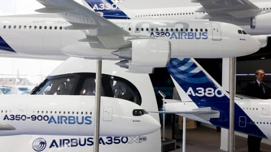 Airbus exhibition stand showing Airliner fleet of A350, A380, A320 and A330 at the Farnborough Air Show, England.