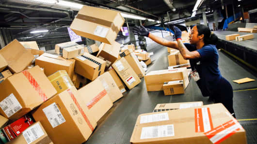 An employee sorts packages inside the FedEx distribution hub at Los Angeles International Airport.