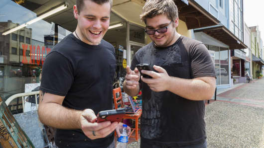 "Brothers Jon and Ryan Edmonds play the augmented-reality smartphone game Pokémon Go in downtown Texarkana, Arkansas on Saturday, July 9, 2016. Released July 5, the game allows players to ""catch"" characters that appear to be in the real world using GPS and the smartphone camera."