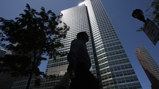 A pedestrian passes in front of 200 West St., which houses the headquarters of Goldman Sachs Group, in New York.