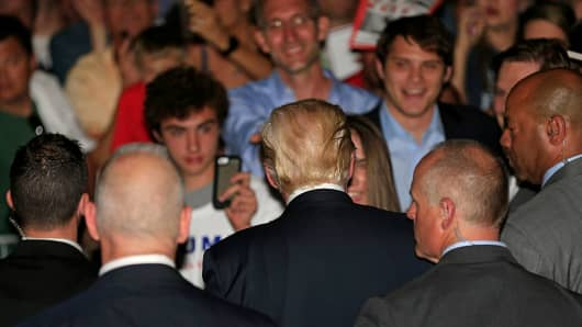 Flanked by members of the Secret Service, Republican presidential candidate Donald Trump