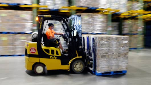 A forklift operator moves bottles of Poland Spring water at the Hollis facility in Hollis, Maine.
