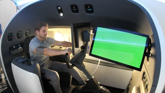 An athlete riding an exercise bike in the Sukhoi SportJet while sensors track his physiological changes.
