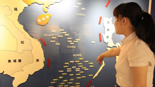 A guide explains in front of the 3D map of South China Sea at Nanjing Ocean National Defense Education Museum on July 12, 2016 in Nanjing, Jiangsu Province of China.