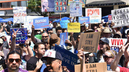Bernie Sanders supporters with signs at the Team Bernie LA Rally on June 26, 2016 in Los Angeles, California.