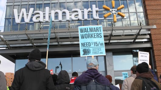 Protesters gather in front of a Walmart store in Washington, D.C., on November 28, 2014, to demand better wages.
