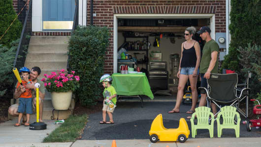 A family plays outside their home in Alexandria, Va.