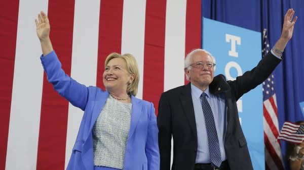 Democratic U.S. presidential candidate Hillary Clinton and Sen. Bernie Sanders stand together during a campaign rally where Sanders endorsed Clinton in Portsmouth, New Hampshire, U.S., July 12, 2016.