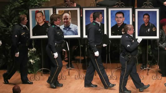Police officers arrive at an interfaith memorial service, honoring five slain police officers, at the Morton H. Meyerson Symphony Center on July 12, 2016 in Dallas, Texas.