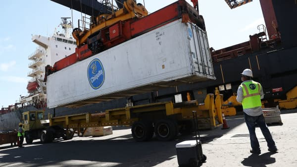 Shipping containers are offloaded from a cargo ship at Port Everglades in Fort Lauderdale, Florida.