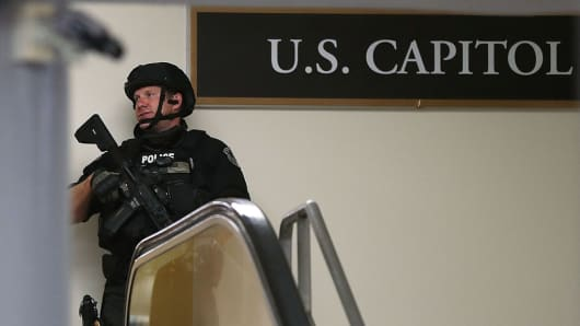 A heavily armed U.S. Capitol Police officer stands guard a hallway at the basement of the Capitol during a lockdown July 8, 2016 in Washington, DC.