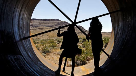 Guests get a chance to view the inside of a Hyperloop tube during the first open air propulsion test at the Hyperloop One Test and Safety site on May 11, 2016 in Las Vegas, Nevada.
