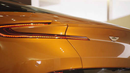 "The back of Aston Martin DB11 does not have a flip-up spoiler. Instead, Aston Martin's chief exterior designer Miles Nürnberger said they designed the car with the ""Classic GT look"" which provides the car with more high-speed stability and less drag."