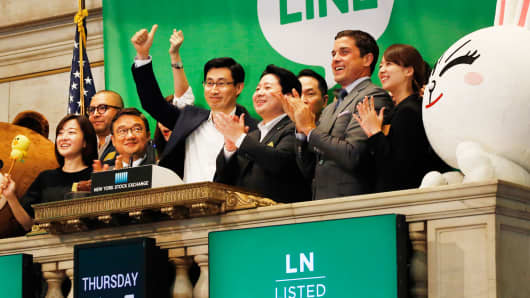 Executives with Japanese messaging app Line celebrate the company's IPO at the New York Stock Exchange, Thursday, July 14, 2016, in New York.