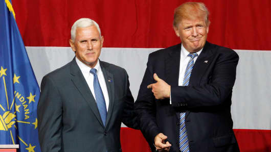 Republican presidential candidate Donald Trump (R) and Indiana Governor Mike Pence (L) before addressing the crowd during a campaign stop at the Grand Park Events Center in Westfield, Indiana, July 12, 2016.
