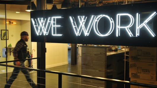 A man enter the doors of the 'WeWork' co-operative co-working space in Washington, DC.