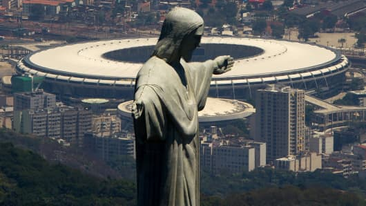 The Christ the Redeemer statue, with the Maracanã Stadium in the background, Rio de Janeiro