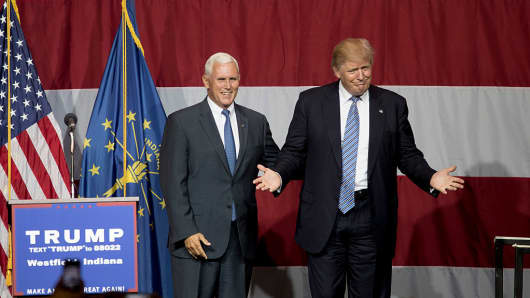 Republican presidential candidate Donald Trump greets Indiana Gov. Mike Pence