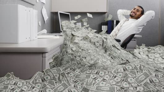 Man sitting in pile of money