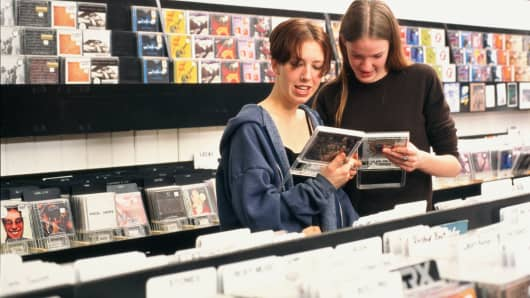 Teenager girls (17-19) shopping for CD's in music store