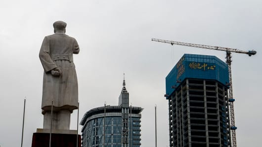 A statue of Mao Zedong on Tianfu Square,  who stands facing the business center of the city of Chengdu in China.