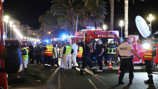 A truck ploughed into a crowd in the French resort of Nice on July 14, leaving at least 60 dead and scores injured in an 'attack' after a Bastille Day fireworks display, prosecutors said on July 15, 2016.