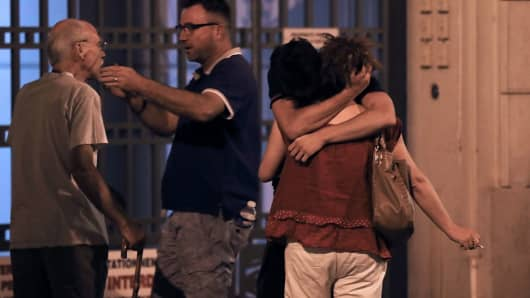 People mourn after the Nice attack on July 14, 2016.