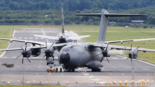 An Airbus A400M Atlas four-engine turboprop military transport aircraft on display at the 2016 Farnborough International Airshow.