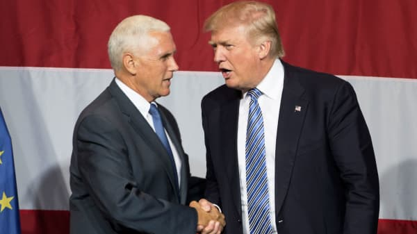 Presumptive US Republican presidential candidate Donald Trump (R) greets Indiana Governor Mike Pence (L) during a campaign rally at Grant Park Event Center in Westfield, Indiana, on July 12, 2016.