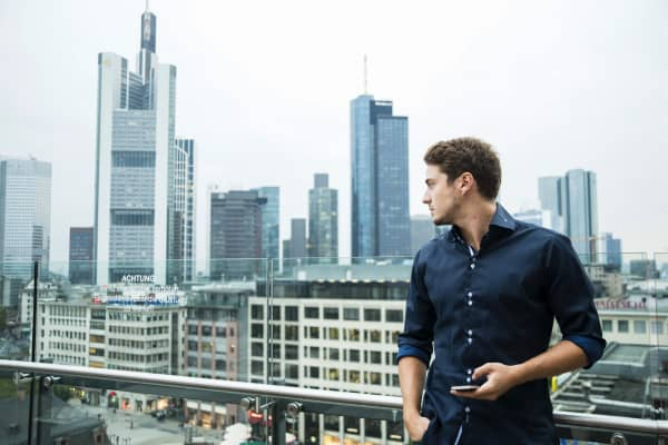Young professional overlooking cityscape