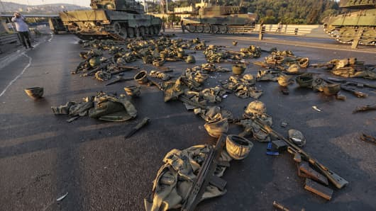 Clothes and weapons beloging to soldiers involved in the coup attempt that have now surrendered lie on the ground abandoned on Bosphorus bridge on July 16, 2016