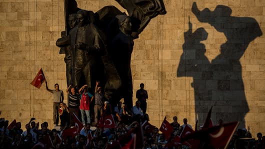 People gather in front of Parliament House to listen to official speeches during a rally in reaction to the attempted military coup on July 16, 2016 in Ankara, Turkey.