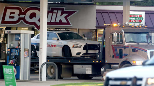 A East Baton Rouge Police car is seen on a trailer as it is towed from the crime scene at the B-Quik gas station on Airline Hwy after three police officers were killed this morning on July 17, 2016 in Baton Rouge, Louisiana. The suspect, identified as Gavin Long of Kansas City, is dead after killing three police officers and injuring three more.