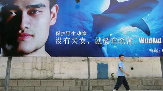 A photo from June 2007 of basketball star Yao Ming on a billboard designed to raise awareness of wildlife preservation. The Chinese eight-time NBA all-star retired in 2011.