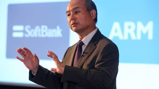 Masayoshi Son, chairman and chief executive officer of SoftBank Group Corp., gestures whilst speaking during a news conference in London, on Monday, July 18, 2016.
