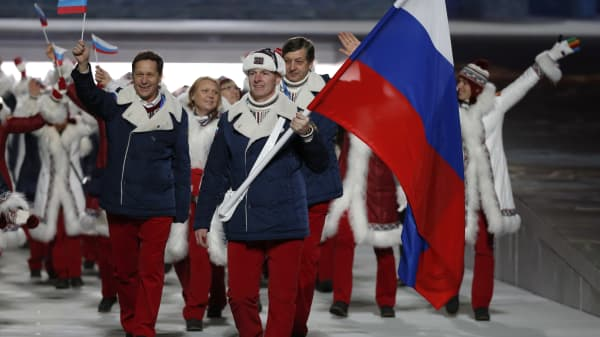 Russia's flag-bearer Alexander Zubkov leads his country's contingent during the athletes' parade at the opening ceremony of the 2014 Sochi Winter Olympics, February 7, 2014.